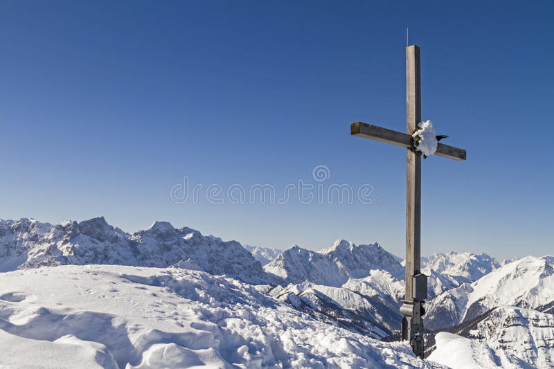 Summit Schafreuter. Wooden cross on summit Schafreuter in winter royalty free stock photos