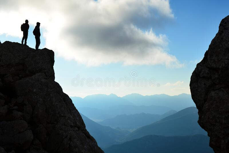 Summit struggle of leading climber, professional duo and successful explorers and stunning views stock photos