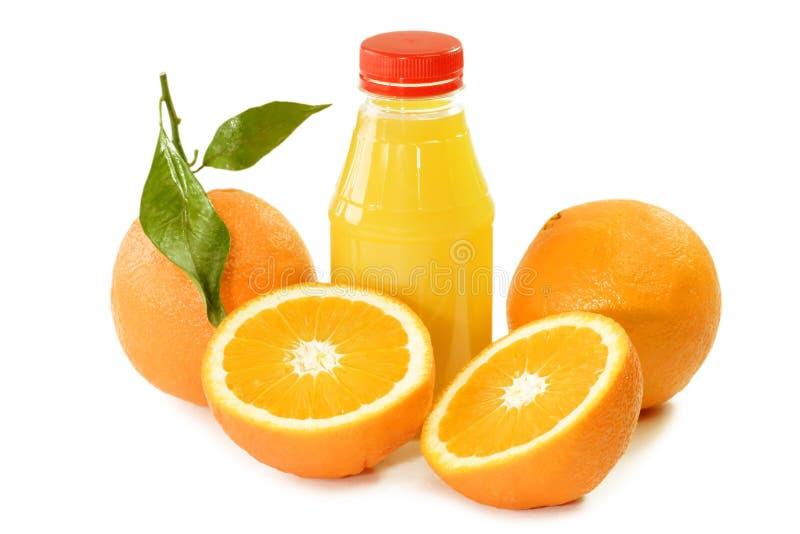 Sumo de laranja em um frasco fotos de stock royalty free