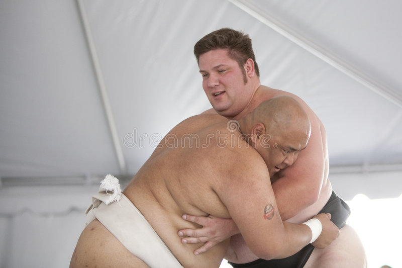 Sumo Wrestlers Grappling. LOS ANGELES - APRIL 5: Dan Kalbfleisch (R) and Americus Abesamis (L) grapple at a Sumo wrestling demonstration at the Little Tokyo royalty free stock photo