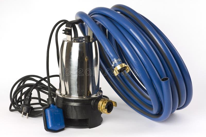 Sump pump and water hose royalty free stock photos