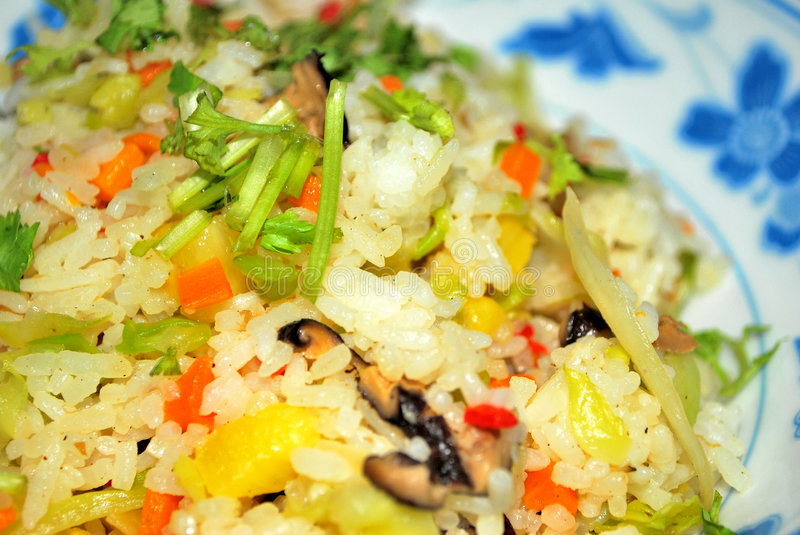 Sumptuous pineapple fried rice. Cooked Chinese style. A very healthy looking vegetarian meal royalty free stock images
