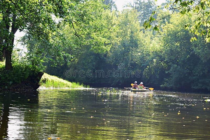Sumy region, Ukraine, August, 2019. Vorskla river, tourists on a kayak. Sumy region, Ukraine, August, 2019. Vorskla river, tourists swim on the river in kayaks royalty free stock photos
