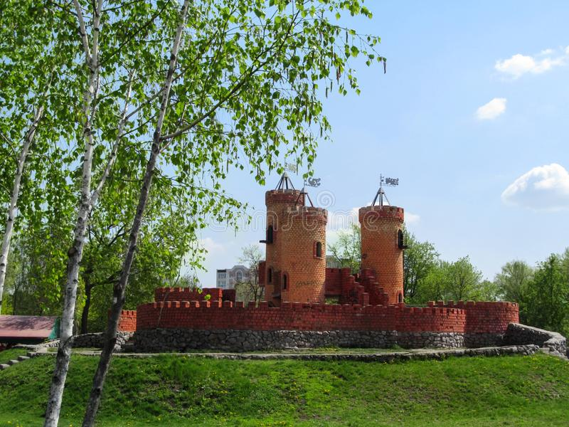 Fabulous medieval brick castle with three towers in the park `Kazka` in Sumy royalty free stock images