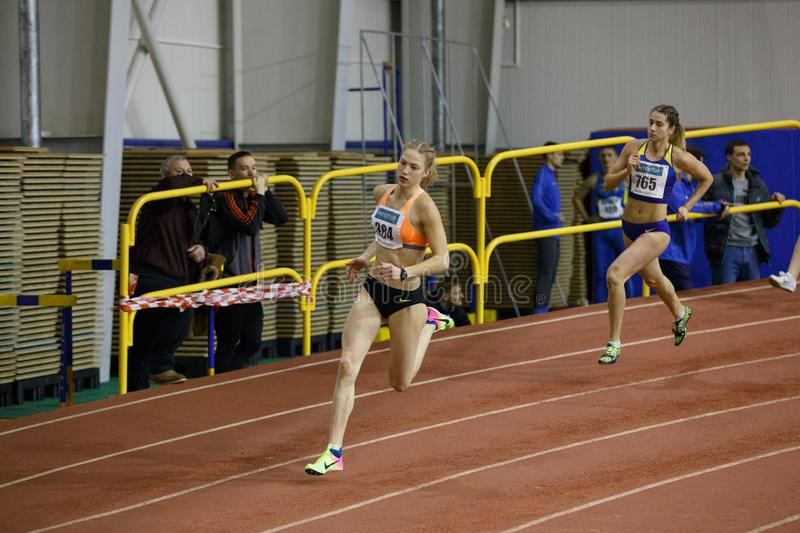 SUMY, UKRAINE - FEBRUARY 9, 2018: Alina Shukh - champion in pentathlon competition on Ukrainian indoor track and field. Championship 2018 running 800m race royalty free stock images