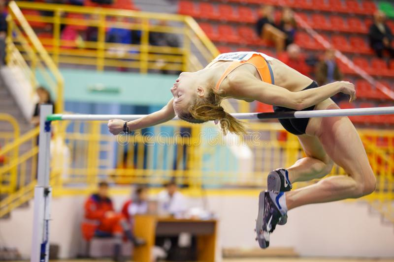 SUMY, UKRAINE - FEBRUARY 9, 2018: Alina Shukh - winner of pentathlon competition on Ukrainian indoor track and field. Championship 2018 performing high jump royalty free stock images