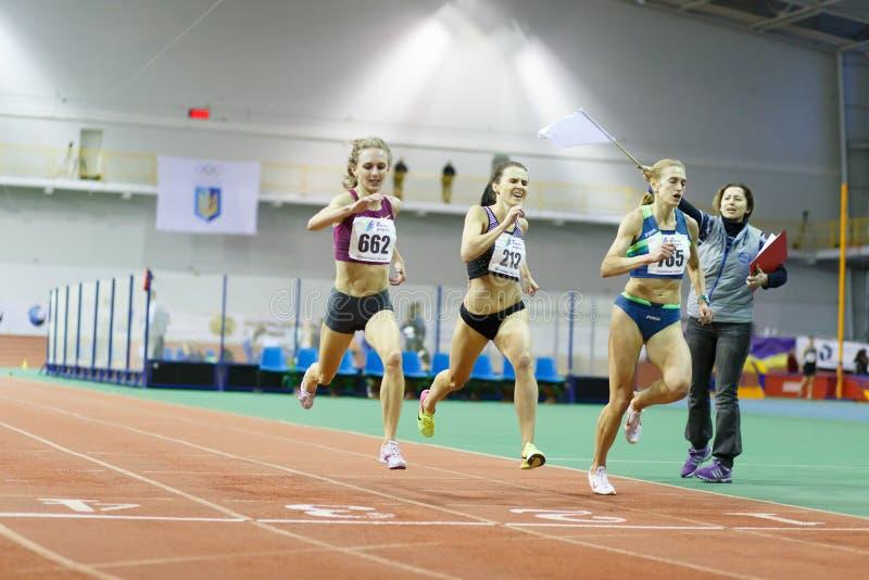 SUMY, UKRAINE - FEBRUARY 17, 2017: finish of 3000m race on Ukrainian indoor track and field championship 2017. Viktoria. Khapilina gets gold and Mariya royalty free stock photo