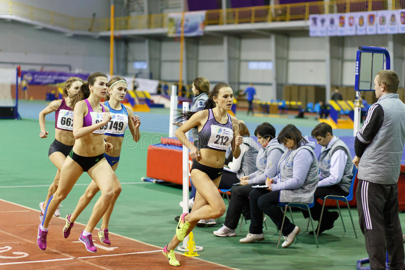SUMY, UKRAINE - FEBRUARY 17, 2017: Mariya Shatalova 212, Olena Sokur 889, Viktoria Khapilina 662 and Nataliia. Strebkova 749 running in final of 3000m race on stock photography