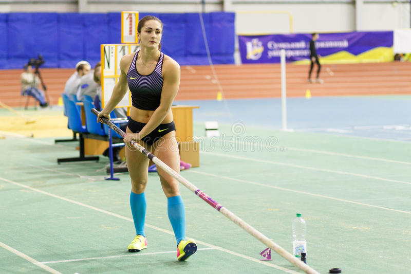 SUMY, UKRAINE - FEBRUARY 17, 2017: Maryna Kylypko before attempt in Pole Vault competition of Ukrainian indoor track and. Field championship 2017 royalty free stock photo