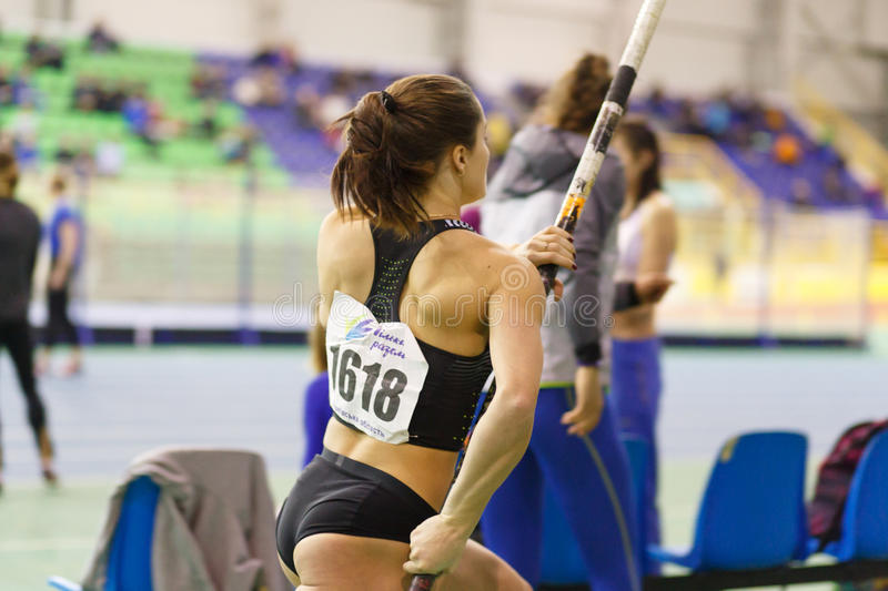 SUMY, UKRAINE - FEBRUARY 17, 2017: Maryna Kylypko got golden medal in Pole Vault competition of Ukrainian indoor track. SUMY, UKRAINE - FEBRUARY 17, 2017: Maryna royalty free stock image