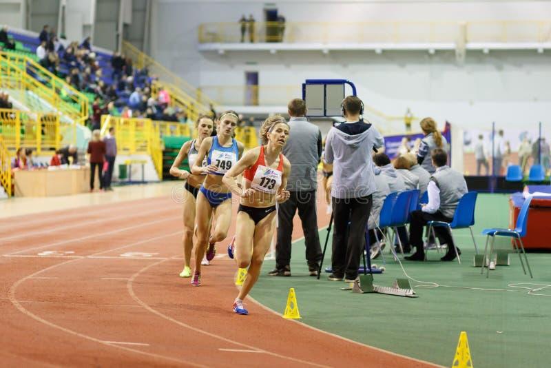 SUMY, UKRAINE - FEBRUARY 17, 2017: Nataliya Tobias 173 and Nataliia Strebkova 749 running in final of 3000m race on. Ukrainian indoor track and field stock image
