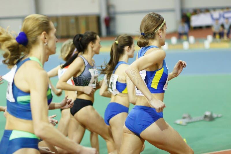 SUMY, UKRAINE - FEBRUARY 17, 2017: start of final race 3000m on Ukrainian indoor track and field championship 2017.  stock image