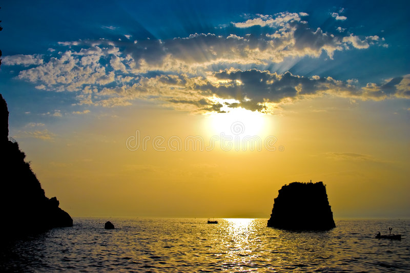 The sun above the sea. The evening sun above the sea and mountains royalty free stock images