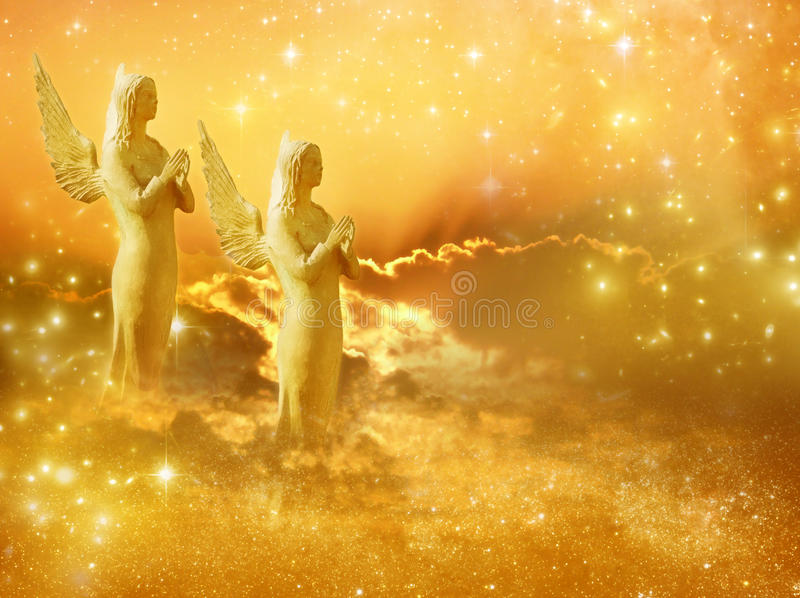 Sun angels. Two angels with stars and sun over cloudy sky stock photos