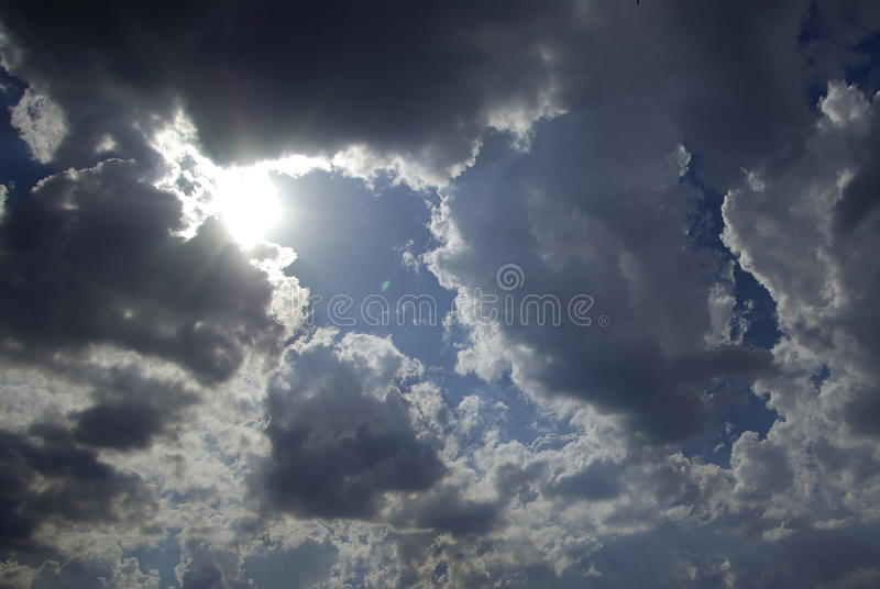 Download Sun Appearance Through Dark Clouds Stock Photo - Image: 10554336