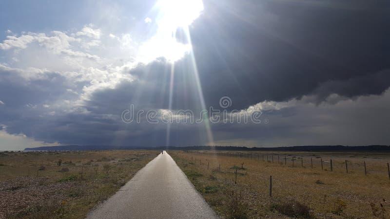 Sun através da nuvem fotografia de stock royalty free