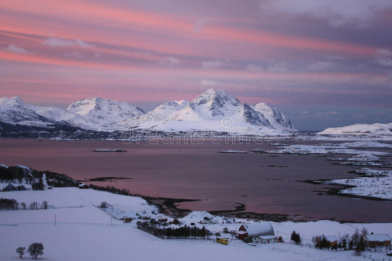 The sun is back in Mortsund. The fjord of Mortsund in Lofoten island, the first day the sunlight is back after the arctic dark period stock photo