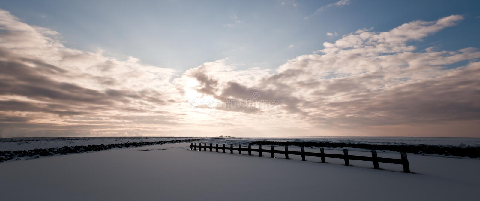 Sun backlit frozen haven royalty free stock photography