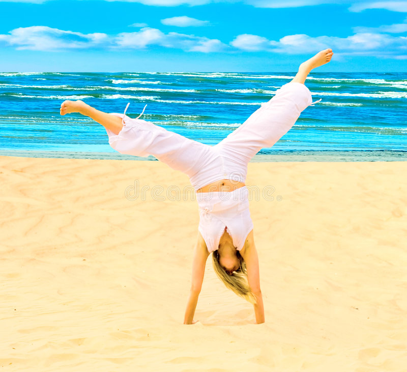 Sun, beach, exercise stock images