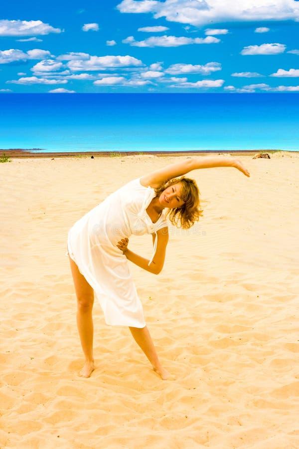 Sun, beach, exercise stock image