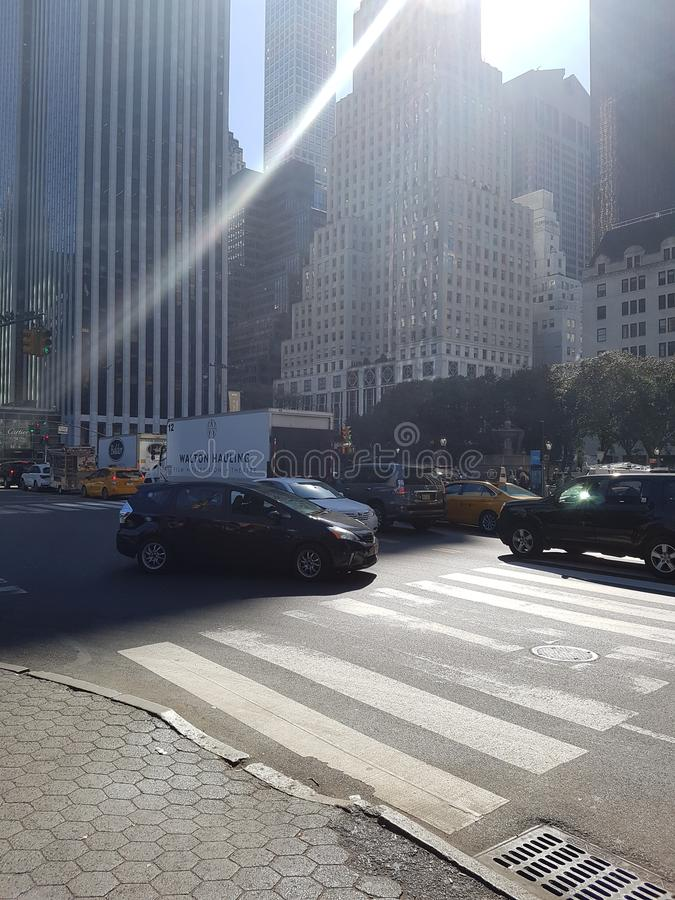 Sun shining on New York Street royalty free stock images
