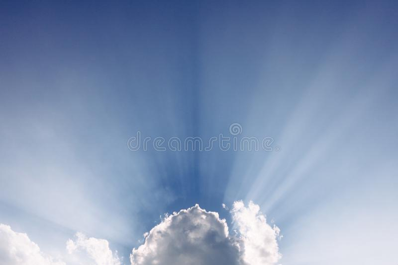 Sun beams from behind a cloud royalty free stock images
