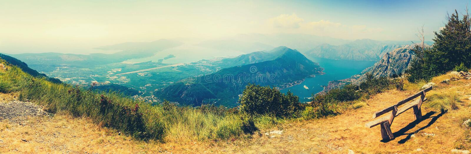 The sun beams light the Kotor bay and green mountains, Montenegro. royalty free stock photo