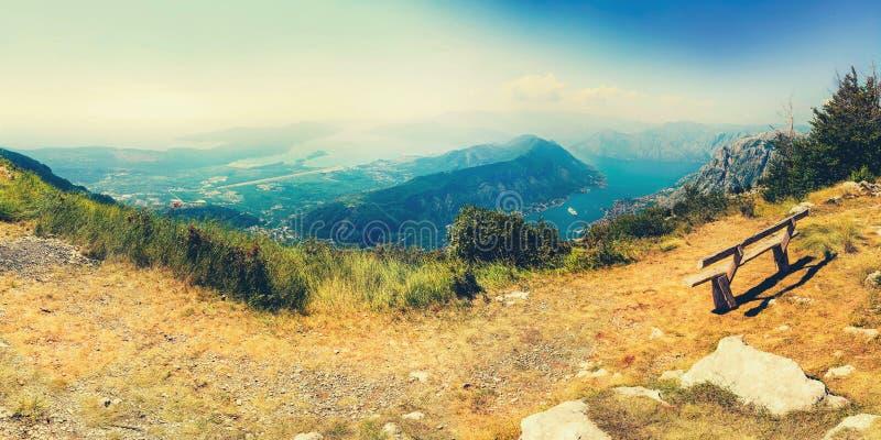 The sun beams light the Kotor bay and green mountains, Montenegro. stock photos