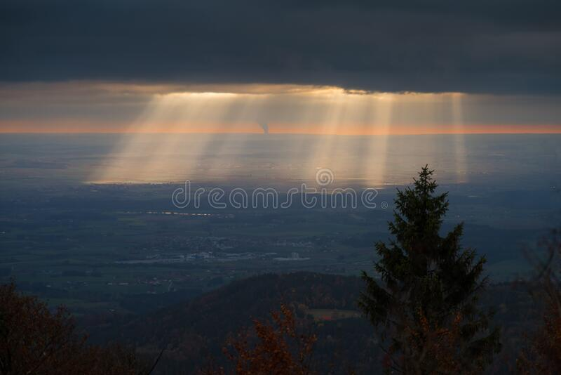 Sun beams over landscape royalty free stock photo