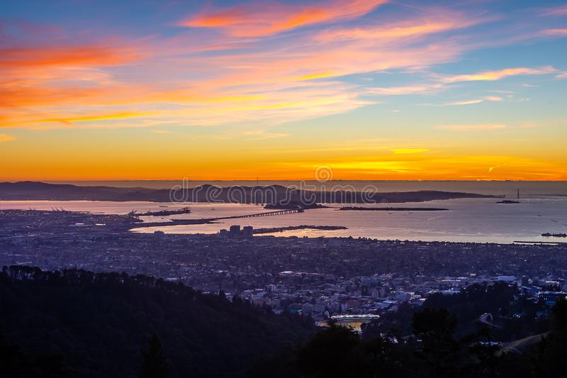 Early morning over the San Francisco Bay. The sun begins to rise over San Francisco and the Golden Gate Bridge royalty free stock images