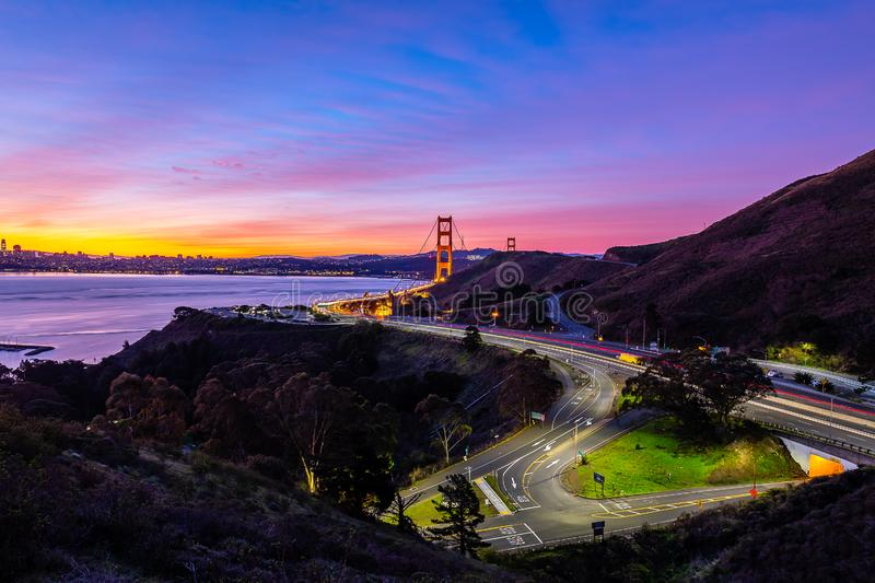 Early morning over the San Francisco Bay. The sun begins to rise over San Francisco and the Golden Gate Bridge stock photo