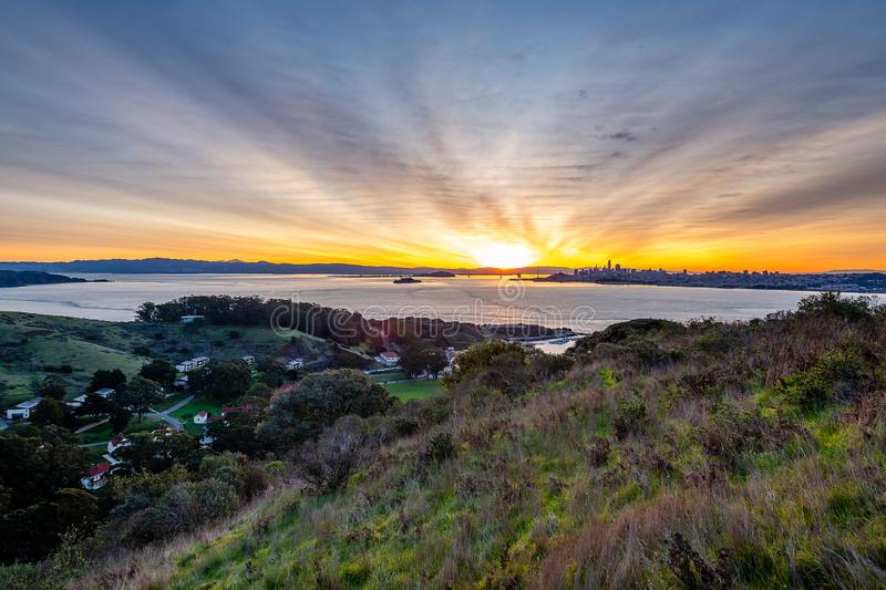 Early morning over the San Francisco Bay. The sun begins to rise over San Francisco and the Golden Gate Bridge royalty free stock image
