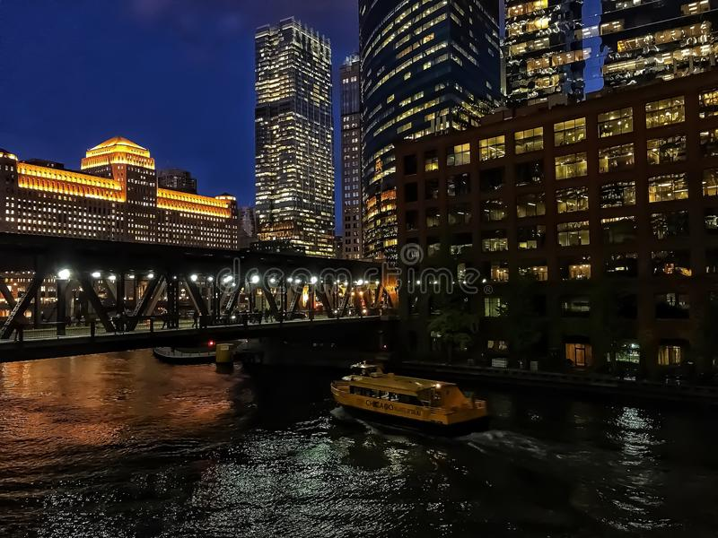Chicago River reflections of sunset and buildings as sun sets royalty free stock photos