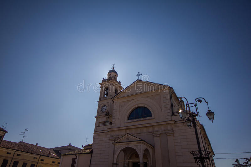Sun behind the bell tower. stock photo