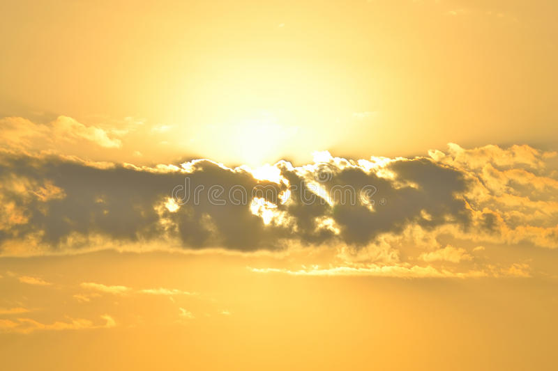 Sun behind the cloud royalty free stock photo