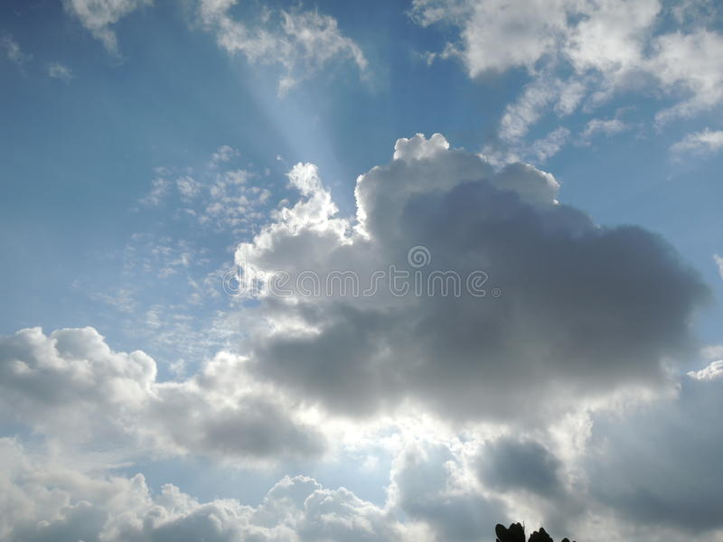 Sun behind the clouds royalty free stock photography