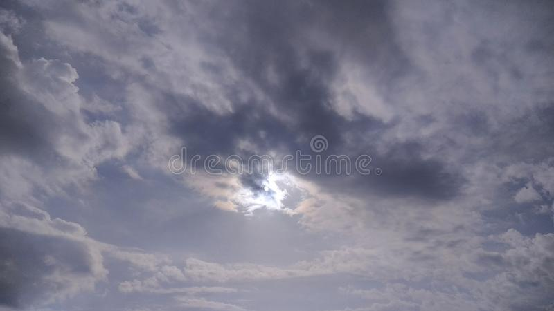 The Sun is behind the Clouds but still shining. stock image