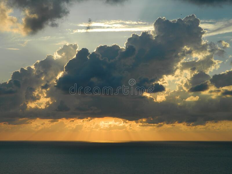 Sun Behind The White Clouds Above Body Of Water During Daytime Free Public Domain Cc0 Image