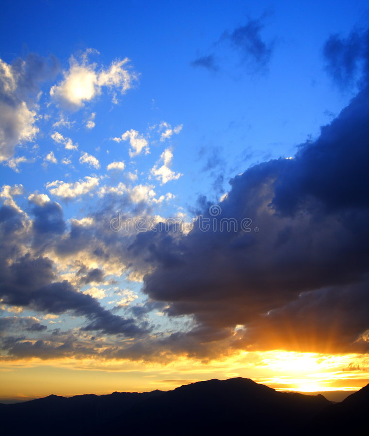 Sun blast and clouds stock images