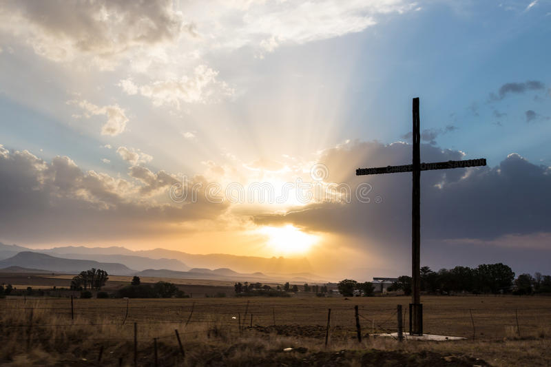 Sun breaking through clouds with cross royalty free stock photography