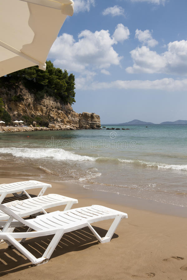 Download Sun Chairs On Alonissos Beach Against Aegean Stock Photo - Image: 21557220