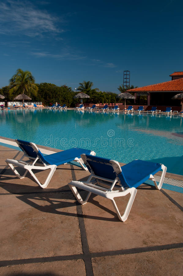 Sun chairs by the pool stock image