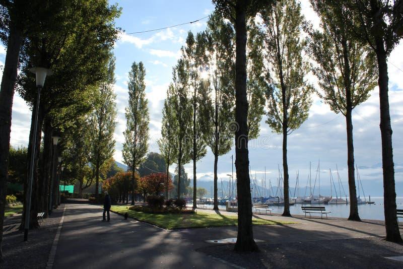 Sun che aumenta sopra il lago Lucerna fotografia stock