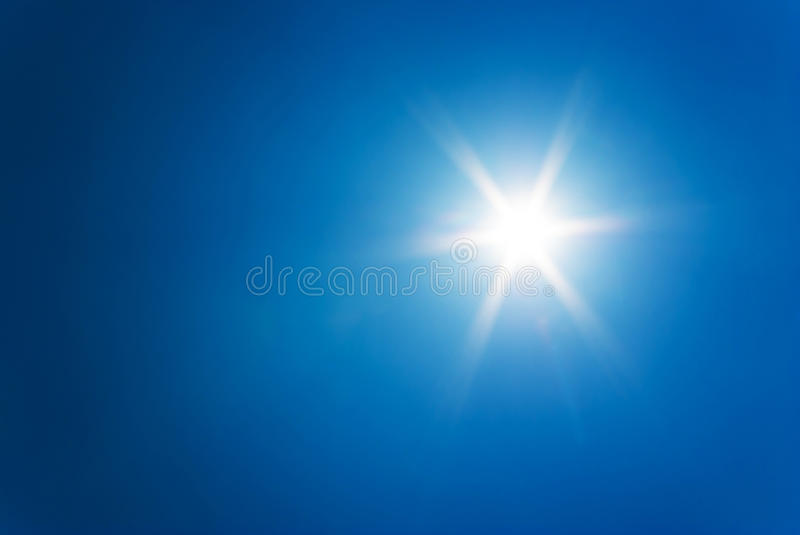 Sun at clear blue sky. Shining sun at clear blue sky royalty free stock image