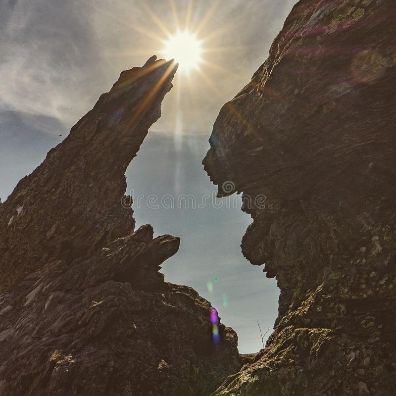 The sun on the cliff edge. Rock, stone, ural, sunlight, sky, blue, day, nature, mineral, geologic, russia royalty free stock photo