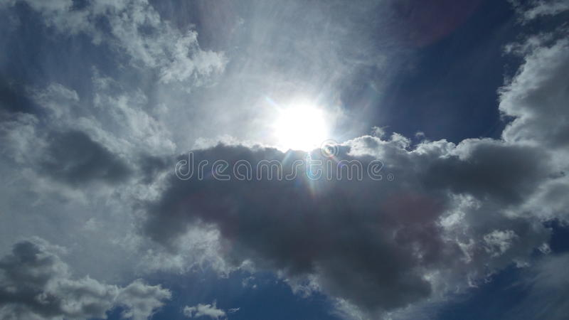 The sun through the cloud stock images