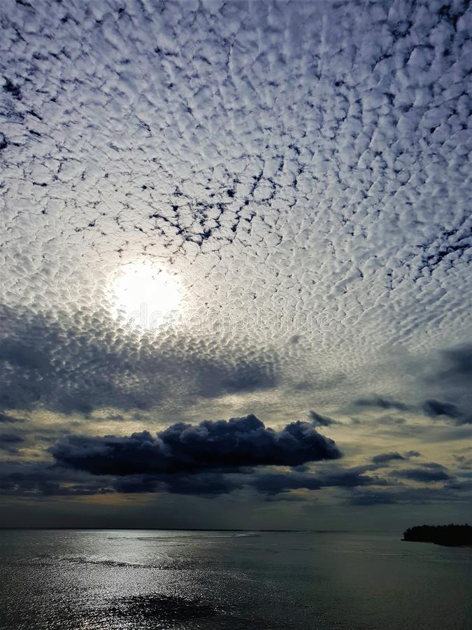 Sun with clouds arranged in pattern mauritius. Sun with clouds arranged in pattern on mauritius island indian ocean stock photography