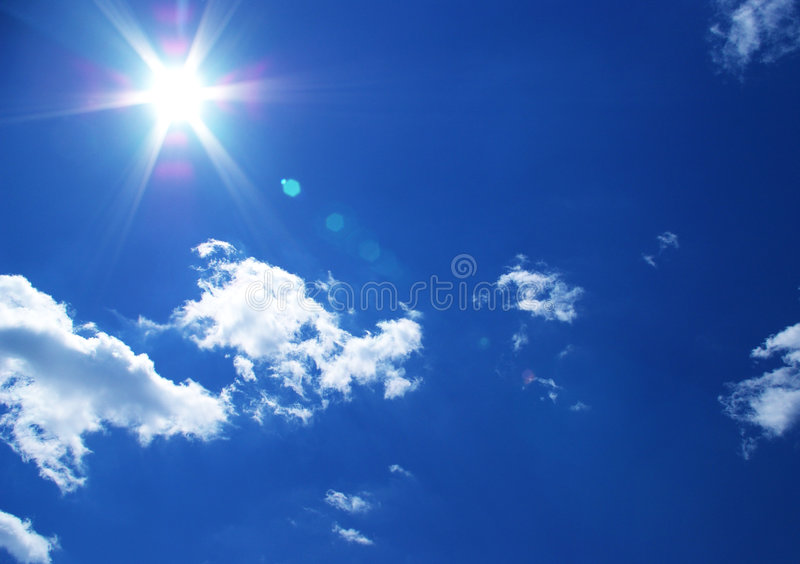 Sun and clouds background royalty free stock photo