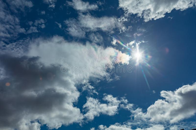 Sun and clouds. Beautiful summer skies background royalty free stock images