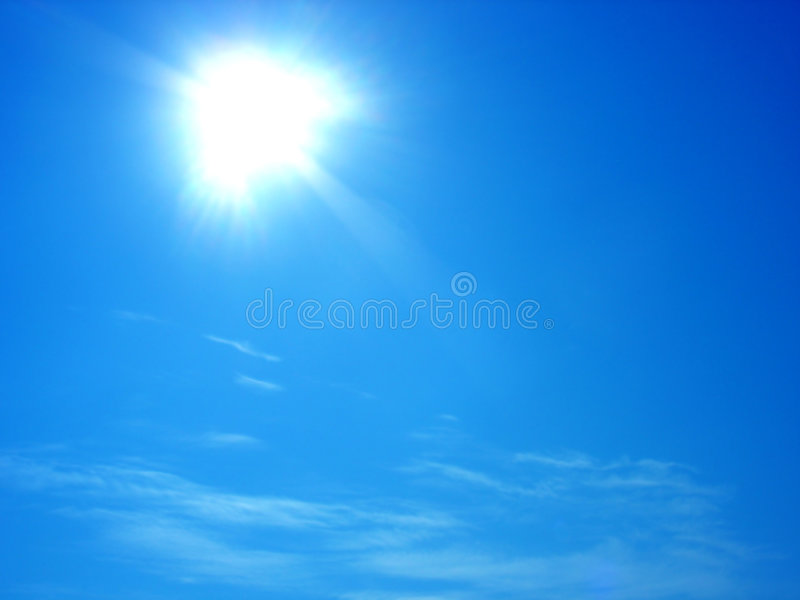 Sun and clouds in blue sky royalty free stock image